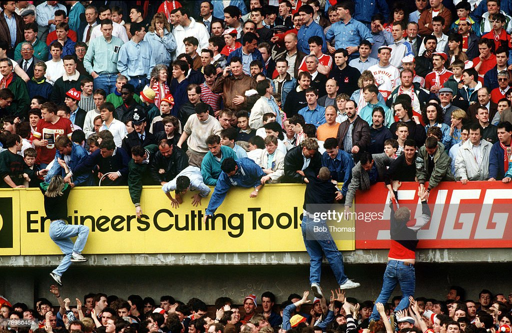 Sport. Football. pic: 15th April 1989. F.A. Cup Semi-Final at Hillsborough. (The Hillsborough Tragedy) Liverpool 0.v Nottingham Forest 0. Match Abandoned. Liverpool fans are pulled to safety on to the upper tier, from the crush that was happening below. : News Photo