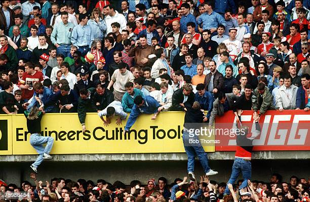 15th April 1989 FA Cup SemiFinal at Hillsborough Liverpool 0v Nottingham Forest 0 Match Abandoned Liverpool fans are pulled to safety on to the upper...