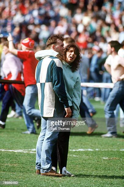 15th April 1989 FA Cup SemiFinal at Hillsborough Liverpool 0v Nottingham Forest 0 Match Abandoned A young couple having escaped the tragedy comfort...