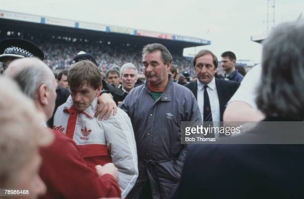 15th April 1989 FA Cup SemiFinal at Hillsborough Liverpool 0v Nottingham Forest 0 Match Abandoned Liverpool Manager Kenny Dalglish is comforted by a...