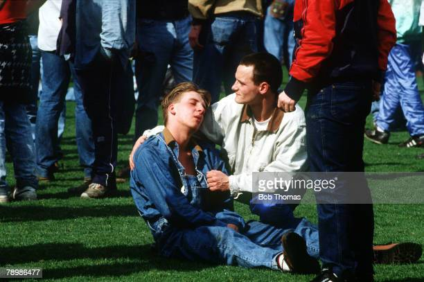 15th April 1989 FA Cup SemiFinal at Hillsborough Liverpool 0v Nottingham Forest 0 Match Abandoned An injured fan is comforted by a friend