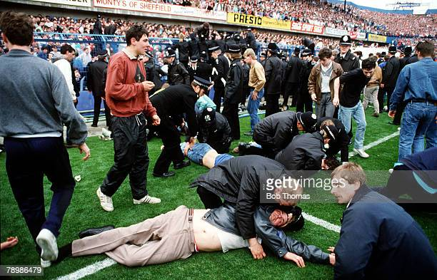 15th April 1989 FA Cup SemiFinal at Hillsborough Liverpool 0v Nottingham Forest 0 Match Abandoned Injured fans are treated on the pitch