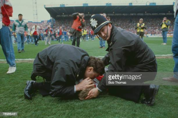 15th April 1989, F.A. Cup Semi-Final at Hillsborough, Liverpool 0,v Nottingham Forest 0, Match Abandoned, A policeman gives mouth to mouth...