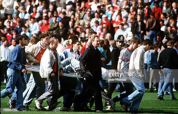 15th April 1989 FA Cup SemiFinal at Hillsborough Liverpool 0v Nottingham Forest 0 Match Abandoned An injured fan is carried on an advertising board...