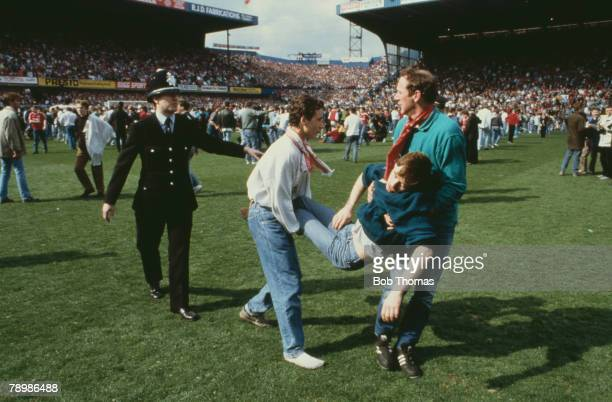 15th April 1989 FA Cup SemiFinal at Hillsborough Liverpool 0v Nottingham Forest 0 Match Abandoned An injured fan is carried away by his friends