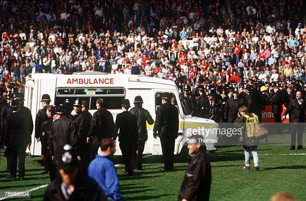15th April 1989, F.A. Cup Semi-Final at Hillsborough, Liverpool 0,v Nottingham Forest 0, Match Abandoned, An ambulance on the pitch, about to rush...