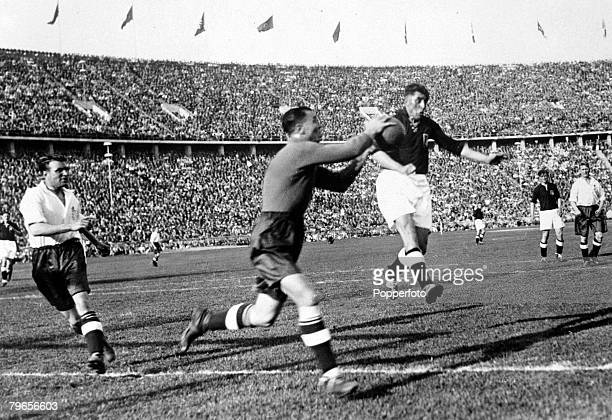 15th May 1938 International Match in Berlin Germany 3 v England 6 England goalkeeper Vic Woodley saves from a German forward as teammate Eddie...