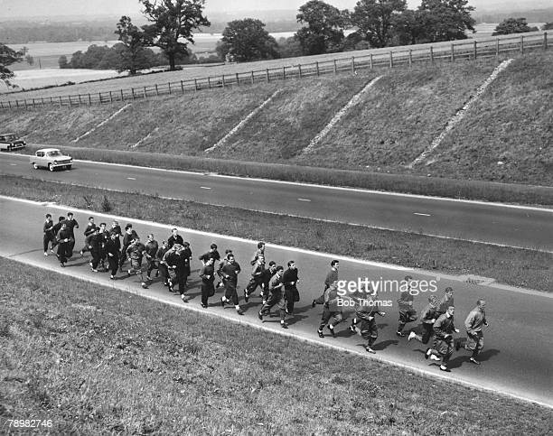 16th July 1962, near London Colney, Hertfordshire, The Arsenal players jog along the A6 road, their first spell of roadwork in the preparation for...