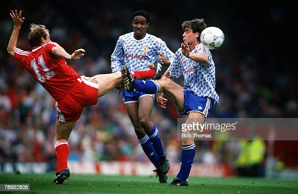 16th September 1990 Division 1 Liverpool 4 v Manchester United 0 Manchester United's Mark Hughes right contests a high ball with Liverpool's Steve...