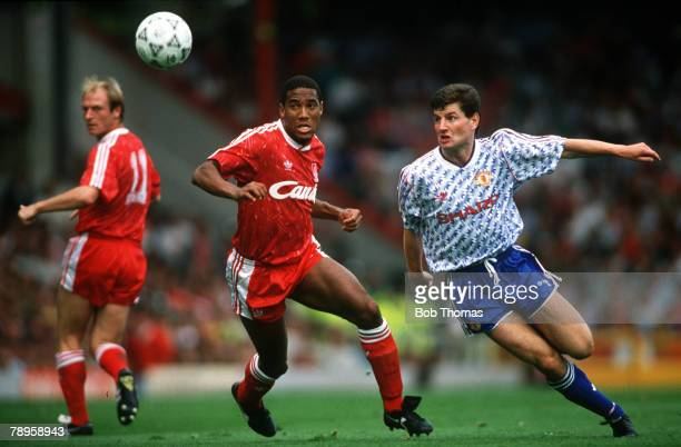 16th September 1990 Division 1 Liverpool 4 v Manchester United 0 Liverpool's John Barnes left and Manchester United defender Dennis Irwin keep their...