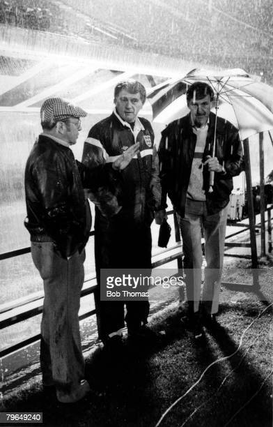 17th February 1988 Tel Aviv Israel 0 v England 0 England Manager Bobby Robson shelters from the rain with BBC Television presenter Jimmy Hill and...