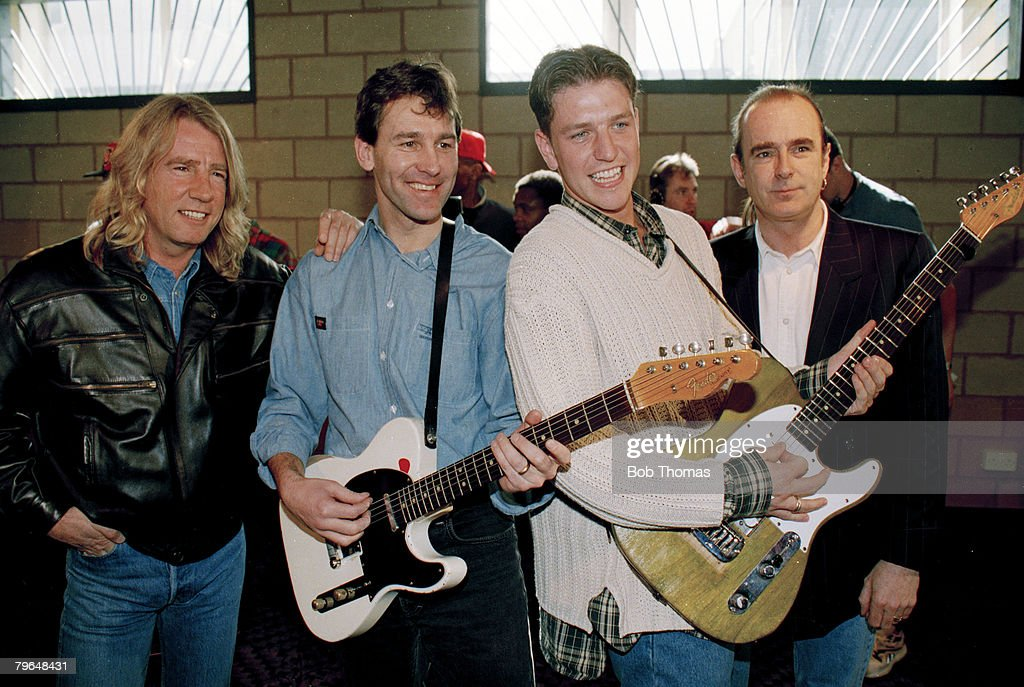 17th March 1994, Manchester United record the song 'Come on you Reds' for their FA Cup Final appearance, Manchester United's Bryan Robson and Lee Sharpe on guitars with British rock group Status Quo's Rick Parfitt, left and Francis Rossi