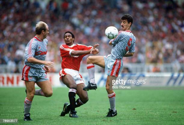 18th August 1990 FA Charity Shield Wembley Liverpool 1 v Manchetser United 1 Manchester United's outnumbered by Liverpool's Steve McMahon left and...