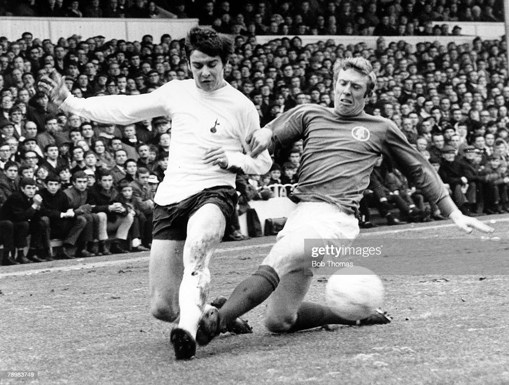 18th January 1969, Division 1, Tottenham Hotspur v Leeds United, Tottenham Hotspur's Cyril Knowles and Leeds United's Mick Jones, right battle for the ball
