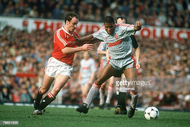 18th March 1990 Division 1 Manchester United 1 v Liverpool 2 Liverpool's John Barnes under pressure from Manchester United's Michael Phelan