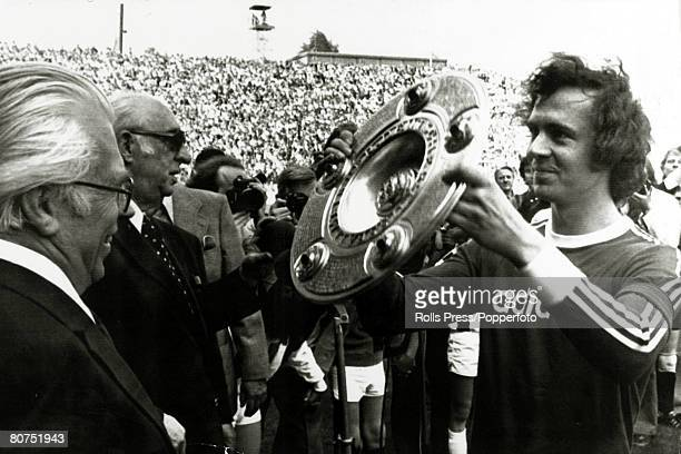 18th May 1974 Moenchengladbach Bayern Munich's Franz Beckenbauer right holds aloft the West German Championship trophy before their game with...