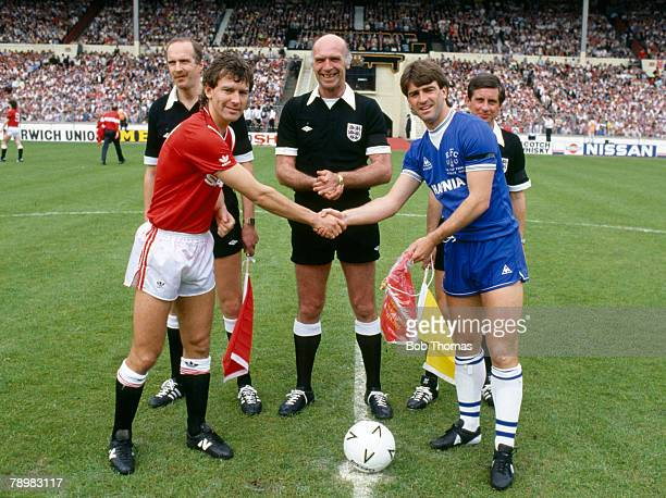 18th May 1985 FA Cup Final at Wembley Everton 0 v Manchester United 1 aet Everton captain Kevin Ratcliffe right meets Manchester United's Bryan...