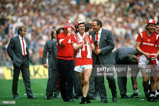 18th May 1985 FA Cup Final at Wembley Everton 0v Manchester United 1 aet Manchester United's John Gidman and Manager Ron Atkinson celebrate with the...
