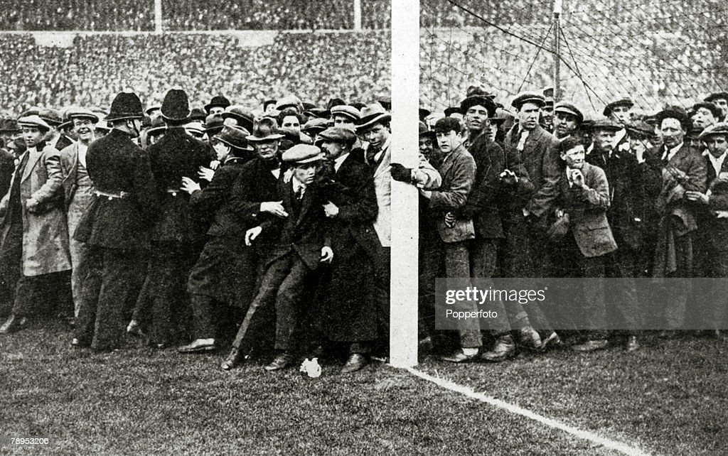 Sport. Football. pic: 1923. 1923 FA.Cup Final at Wembley. Bolton Wanderers 2. v West Ham United 0. Part of the huge crowd almost spilling over on to the pitch as policemen struggle to gain control. : News Photo