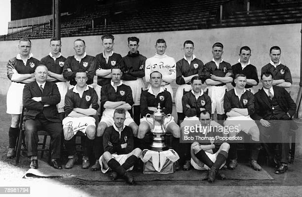 1930 Arsenal FC pictured with the FA Cup after their 20 victory over Huddersfield Town at Wembley Back row leftright Alf Baker Alf Haynes Jack...