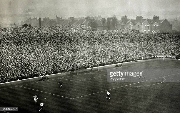 1950 Action from a game at Highbury Arsenal's home ground with the terraces behind the goal packed with supporters