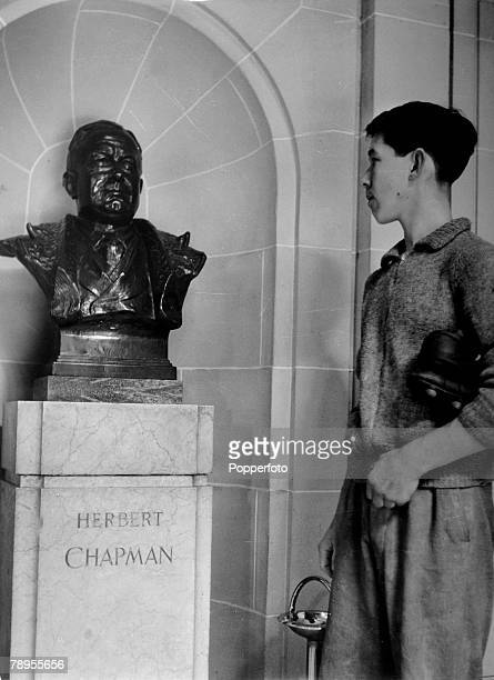 1953 Arsenal FC The marble entrance hall at Highbury Stadium home of the Gunners shows the bust of Herbert Chapman being admired by a ground staff...