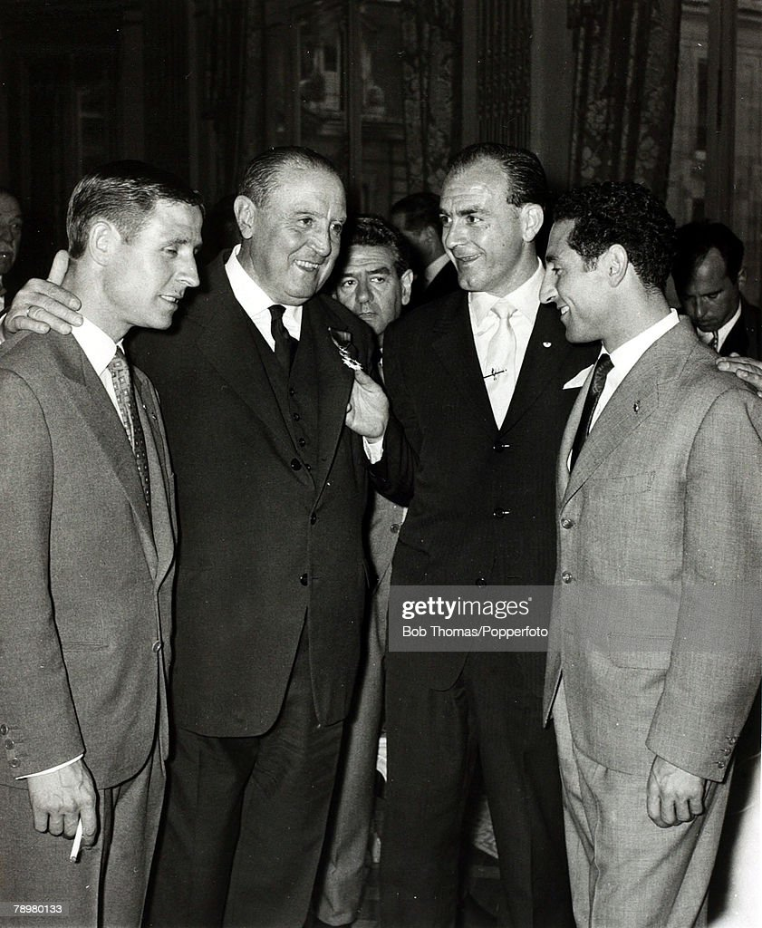 Sport. Football. pic: 1959. Madrid. Real Madrid President Santiago Bernabeu, 2nd left, with Raymond Kopa, left, and Alfredo Di Stefano and Gento at a celebration party after Real had won the European Cup for the 4th consecutive season.The French internati : News Photo
