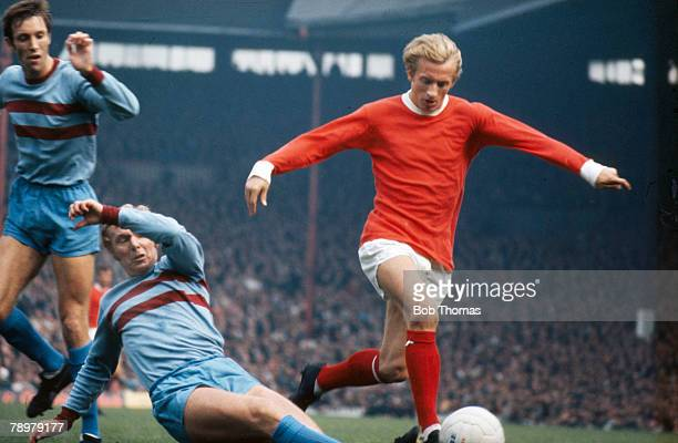 1960's Division 1 Manchester United's Denis Law beats a challenge from West Ham United's Bobby Moore