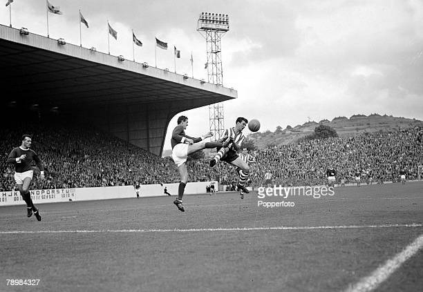 1963 Division 1 Sheffield Wednesday v Manchester United at Hillsborough Manchester United's Bill Foulkes leaps high to stop a Wednesday attack