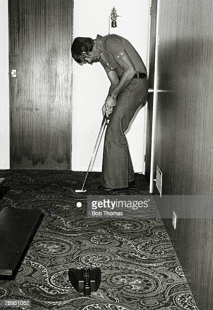 1975 Arsenal's Peter Simpson playing carpet golf at his home in Hertfordshire