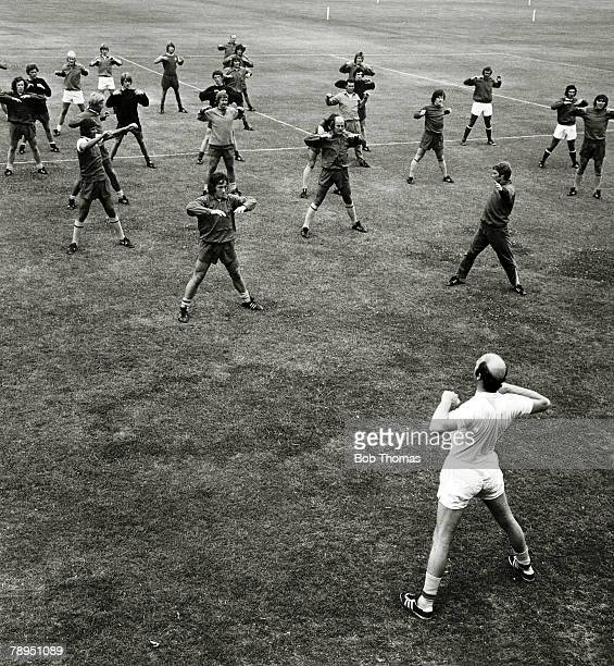 1975 The Arsenal squad limber up with physio Fred Street during training at London Colney