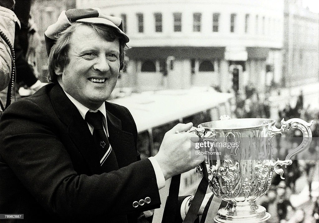 Sport. Football. pic: 1980. Wolverhampton Wanderers' Manager John Barnwell holds the League Cup during the team's victory parade throgh the streets of Wolverhampton. : News Photo