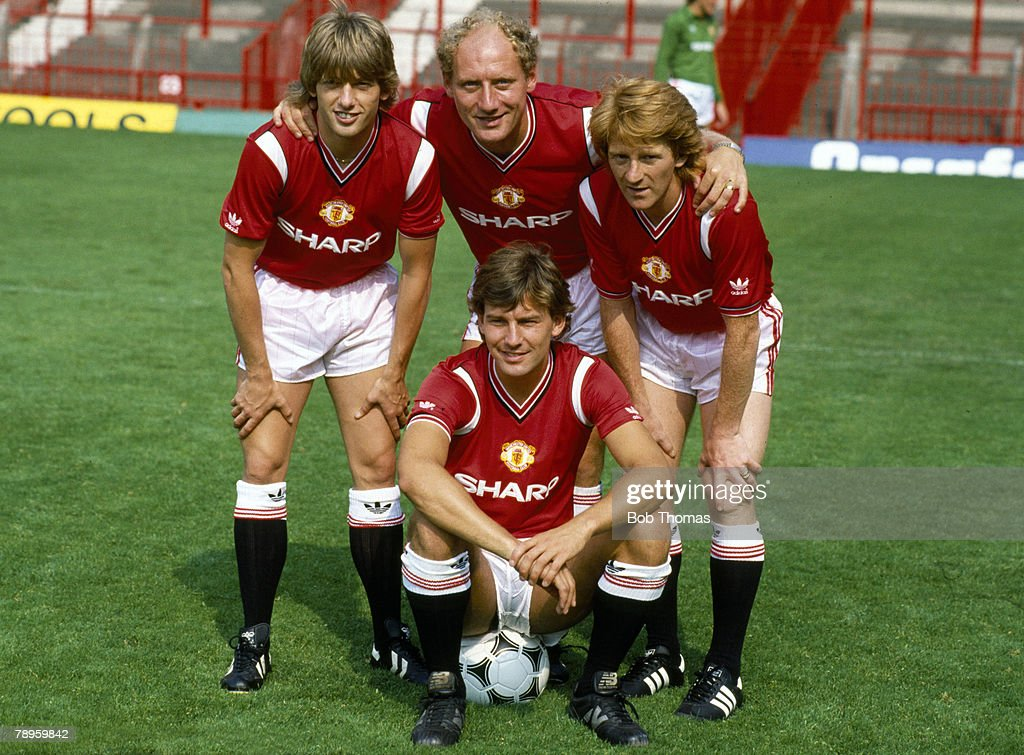 BT Sport. Football. pic: 1984. Old Trafford. Manchester United captain Bryan Robson, front, with the club's new signings left-right, Jesper Olsen, Alan Brazil and Gordon Strachan. : News Photo