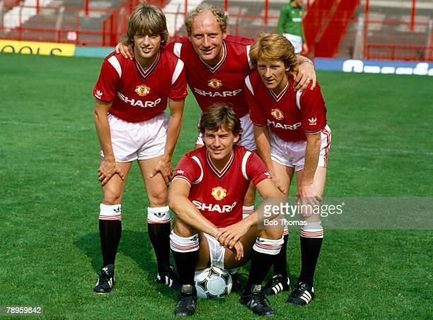 Old Trafford, Manchester United captain Bryan Robson, front, with the club's new signings left-right, Jesper Olsen, Alan Brazil and Gordon Strachan