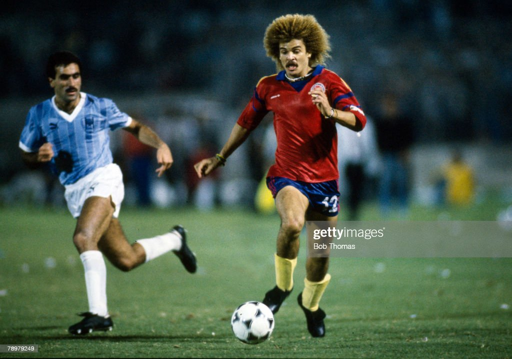 Sport. Football. pic: 1989. World Cup Qualifier Play Off in Tel Aviv. Israel 0 v Colombia 0. Colombia Qualify. Colombia's Carlos Valderrama on the ball with Israel's Shalom Tikua challenging. Carlos Valderrama who was one of the great players won 111 inte : News Photo