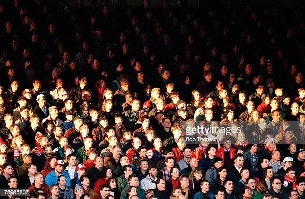 Sport Football pic 1990's Highbury The sun lights up part of the crowd on Arsenal's new North Bank