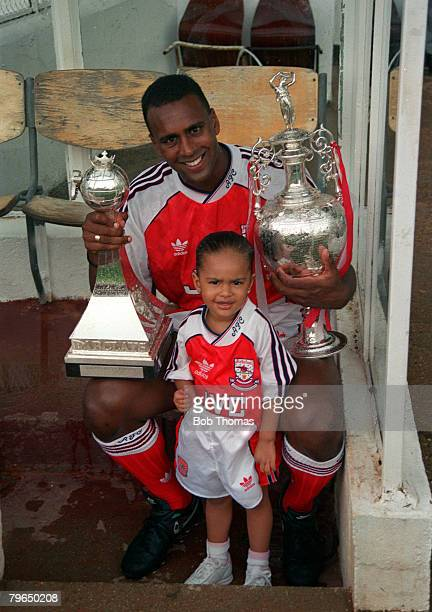 1991 Arsenal's David Rocastle with his child and the First Division Championship trophies won by the club in season 19901991