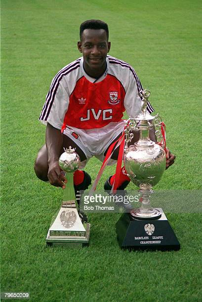1991 Arsenal's Michael Thomas with the First Division Championship trophies won by the club in season 19901991