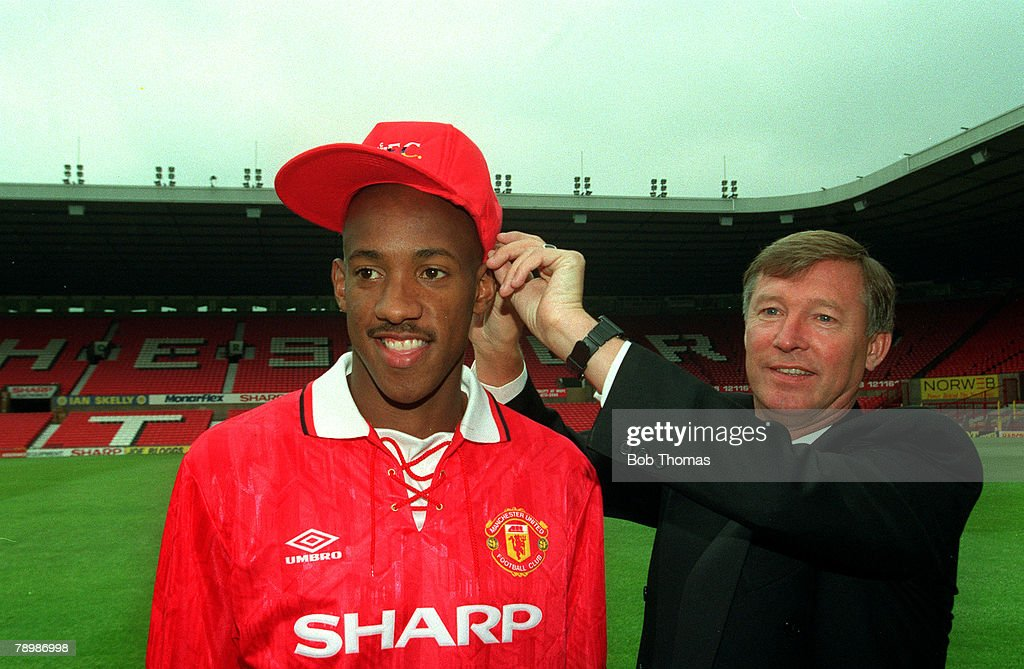 Sport. Football. pic: 1992. Dion Dublin, Manchester United's new signing with the United Manager Alex Ferguson at Old Trafford. : News Photo