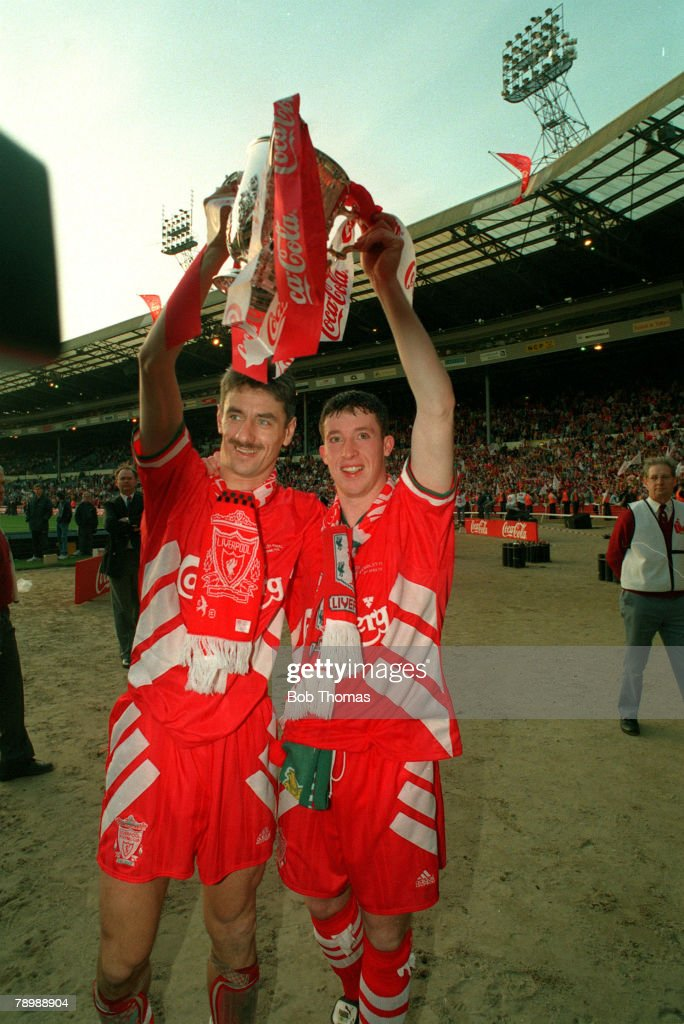 1995, Coca Cola Cup Final, Liverpool 2, v Bolton Wanderers 1, Liverpool's Ian Rush, left, and Robbie Fowler celebrate with the trophy