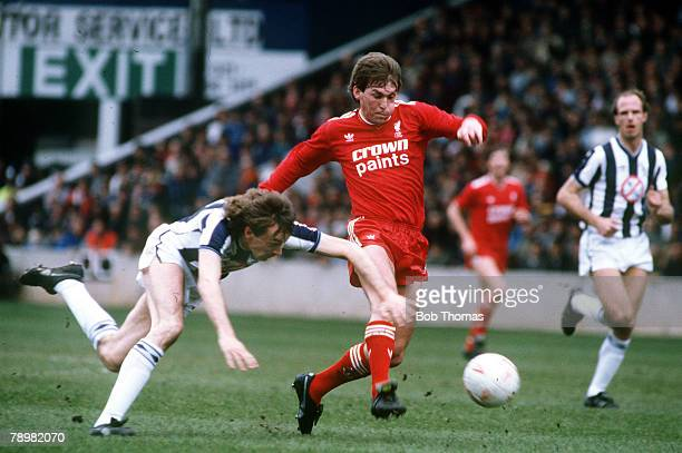 19th April 1986 Division 1 West Bromwich Albion 1 v Liverpool Liverpool's Kenny Dalglish races away as West Bromwich Albion's Barry Cowdrill stumbles...
