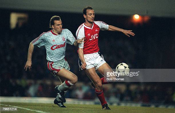 19th April 1990 Division 1 Arsenal 1 v Liverpool 1 Arsenal's Steve Bould and Liverpool's Ronnie Rosenthal in a race for the ball