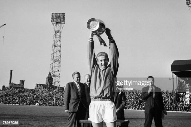 19th May 1965 InterCities Fairs Cup Quarter Final Manchester United v Racing Strasbourg Manchester United's Denis Law raises the League Championship...
