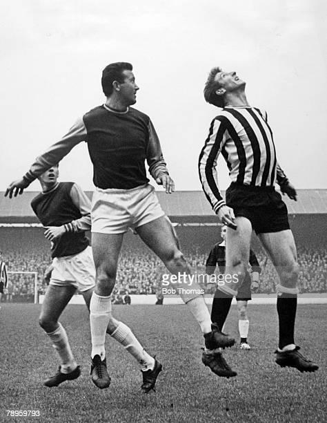 19th November 1966 Division 1 West Ham United 3 v Newcastle United 0 Newcastle United's Wyn Davies right jumps alongside West Ham United's Ken Brown