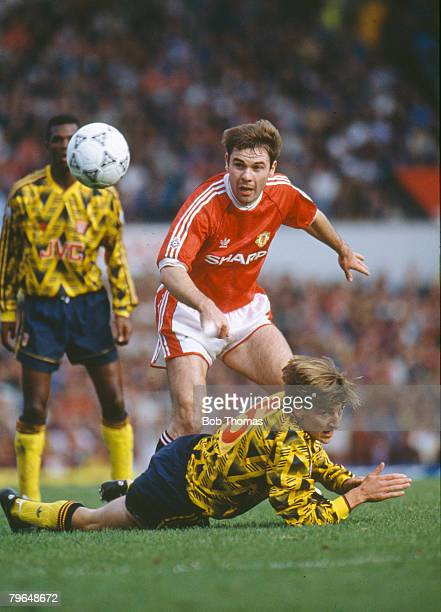19th October 1991 Division 1 Manchester United 1 v Arsenal 1 Manchester United's Brian McClair has his way blocked by Arsenal defender Colin Pates...