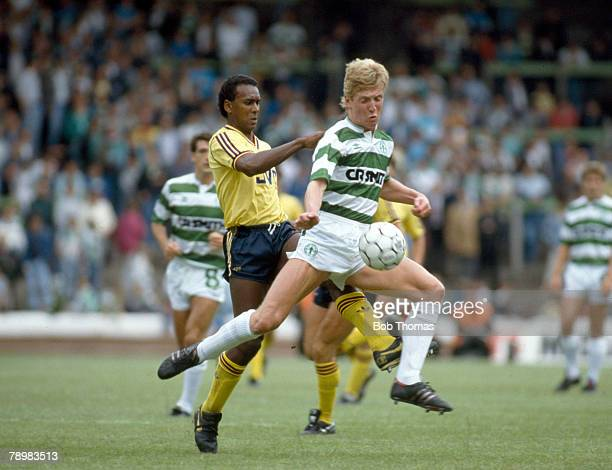 1st August 1987 PreSeason Friendly Celtic 1 v Arsenal 5 Celtic's Anton Rogan is challenged by Arsenal's David Rocastle