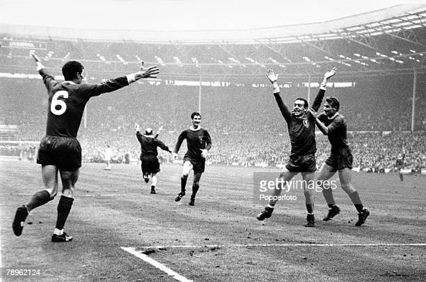 1st May 1965 FA Cup Final at Wembley Liverpool 2 v Leeds United 1 aet Liverpool's Ian St John is grabbed by teammate Roger Hunt after St John had...