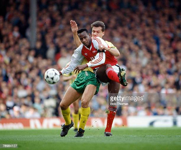 1st May 1989 Division 1 Arsenal 5 v Norwich City 0 Arsenal's Michael Thomas shoots as a challenge comes in from Norwich City's Dean Coney