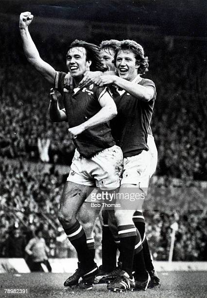 1st October 1977 Division 1 Manchester United 2 v Liverpool 0 Manchester United's Sammy McIlroy has scored the 2nd goal and celebrates with Jimmy...