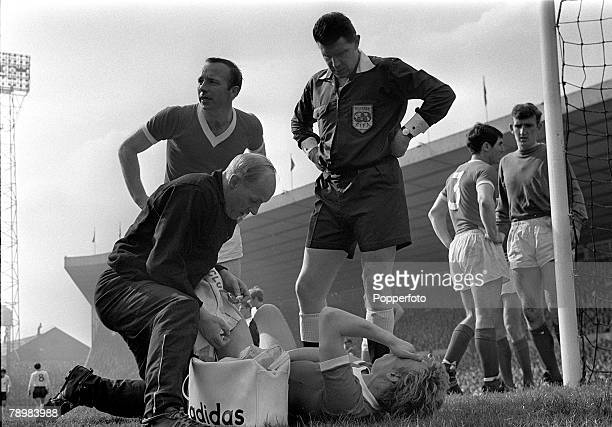 20th April 1968 Division 1 Manchester United 1 v Sheffield United 0 at Old Trafford Manchester United's Denis Law lying injured is treated by Jack...